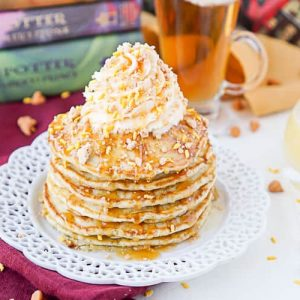 Stack of butterbeer pancakes on a white plate