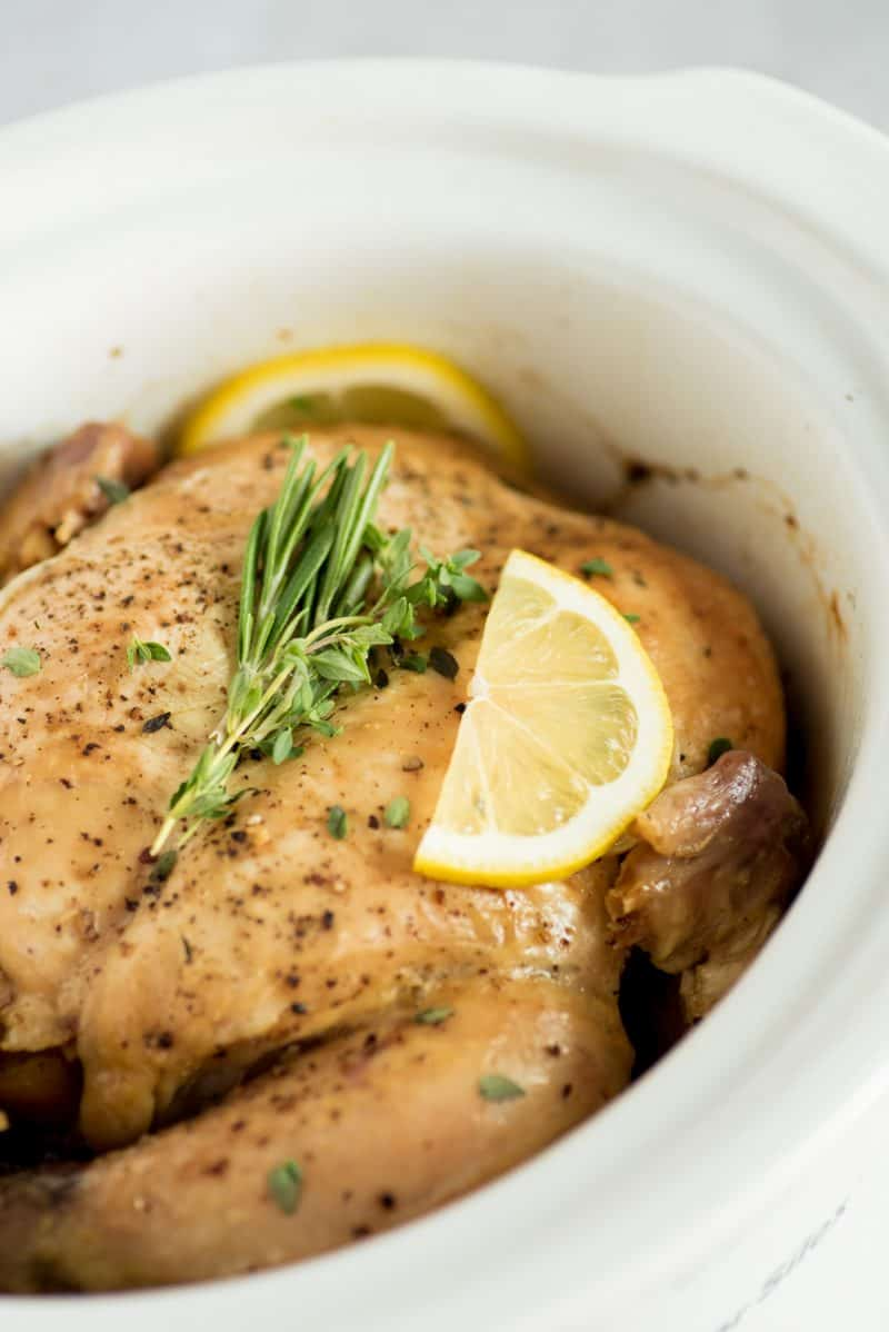 Close up of whole chicken in crock pot