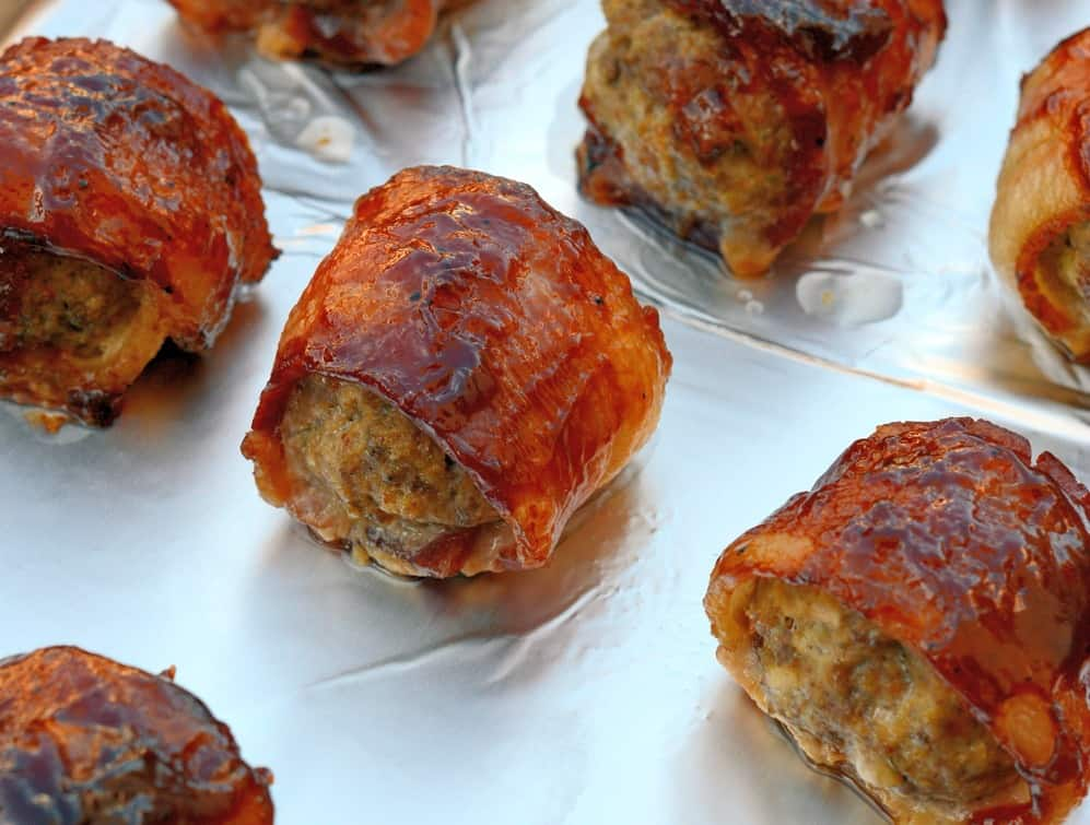 BBQ bacon wrapped meatballs on foil
