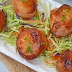 BBQ Bacon Wrapped Scallops are an easy and tasty seafood appetizer or dinner. With just a handful of ingredients, they're ready in just 15 minutes! #baconwrappedscallops #bakedscallops www.savoryexperiments.com