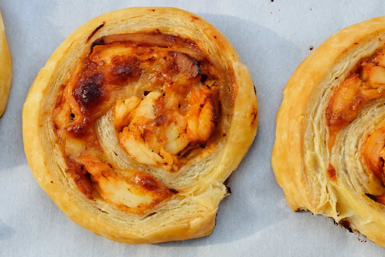 BBQ Chicken Pinwheels are a simple puff pastry appetizer, made with chicken, BBQ sauce, mayo and cheese. Easy, cheesy and deliciously flaky, it'll become one of your go-to pinwheel recipes. #puffpastryrecipes #appetizerrecipes #pinwheels www.savoryexperiments.com