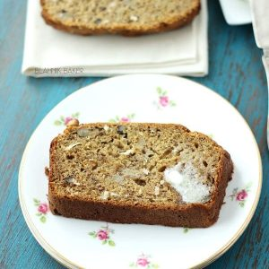 A slice of banana coconut bread on a floral plate