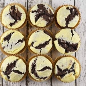 Black bottom cupcakes are a delicious combination of chocolate cupcake bottom and vanilla cream cheese filling. Easy to make and so tasty! #blackbottomcupcakes #blackbottommuffins #creamcheesecupcakes www.savoryexperiments.com