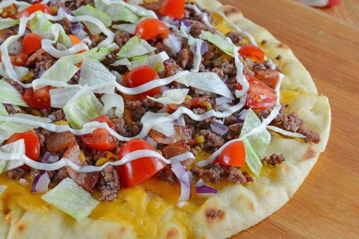 Close up of a cheeseburger pizza