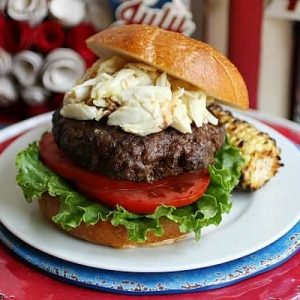 Chesapeake crab burger on a red, white and blue plate
