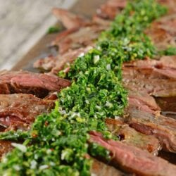 Skirt Steak Chimichurri is a grilled steak recipe that'll leave you drooling! Easy to make and topped with a delicious chimichurri sauce. #whatisskirtsteak #whatischimichurri #grilledsteakrecipe www.savoryexperiments.com