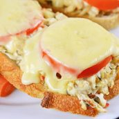 Close up of a crab melt on a white plate