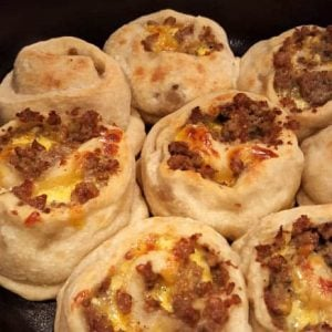 Close up of breakfast pinwheels in a dutch oven