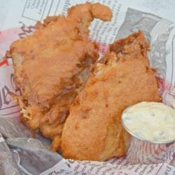 The ultimate fish fry recipe to make beer battered fish for some delicious fish and chips! Quick and easy to make! #fishfryrecipe #fishfrybatter #beerbatteredfish www.savoryexperiments.com