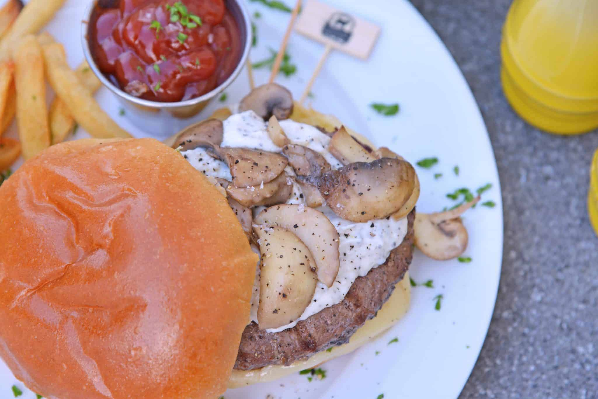 Garlic truffle burger with ketchup on a white plate