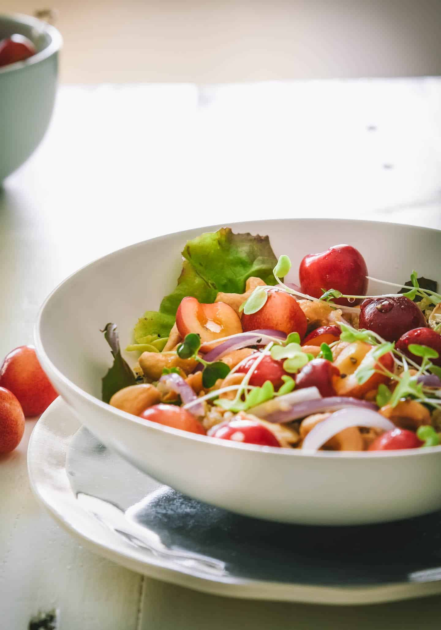 Honey quinoa cherry salad in a white bowl