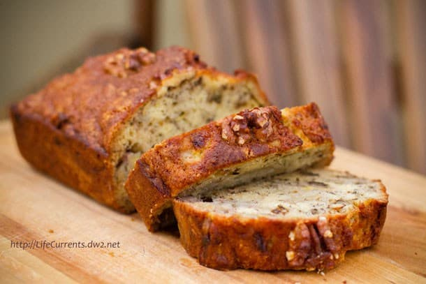 Bourbon banana bread sliced on a wooden cutting board