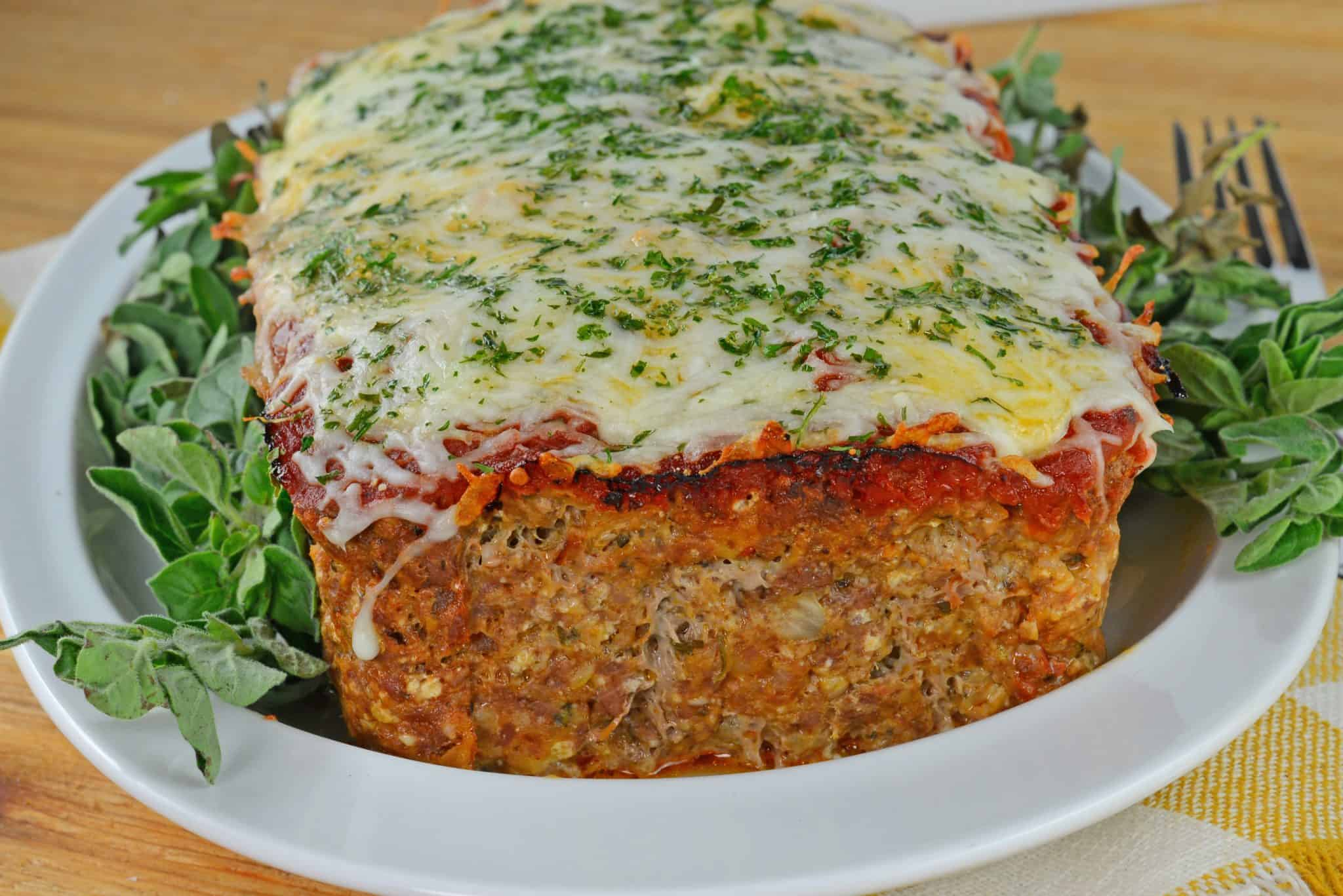 Italian meatloaf topped with cheese