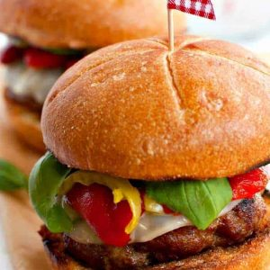 Loaded Italian Sausage Burger with a flag