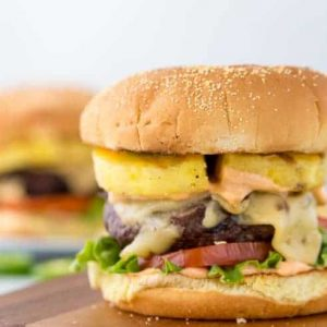 Pineapple jalapeno burger on a wooden board