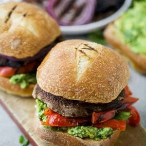 Two portobello burgers on a board