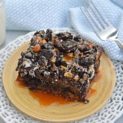 The Ultimate Slutty Brownies are layers of chocolate chip cookie dough, brownie, Oreo cookies, caramel and sea salt. The perfect decadent, sweet and salty easy dessert recipe. #sluttybrownies #bestbrownierecipe www.savoryexperiments.com