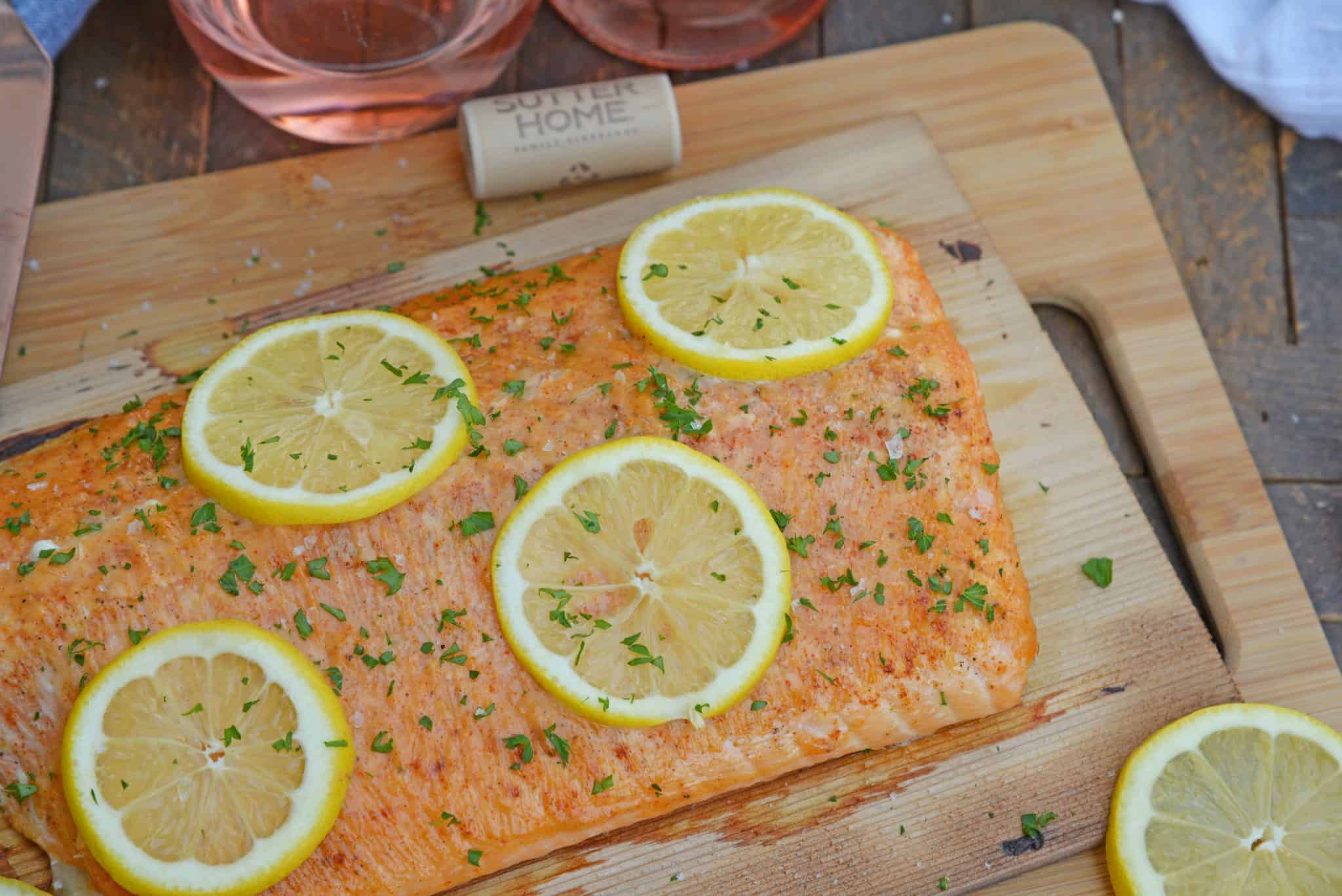 Spicy Cedar Plank Salmon is an easy grilled salmon recipe using a spicy salmon glaze. Perfect for a hot summer night and pairing with a crisp, sweet wine. #cedarplanksalmon #salmononthegrill #spicysalmon www.savoryexperiments.com