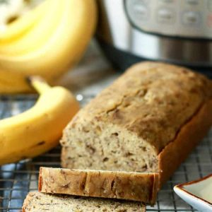 Banana bread sliced with bananas