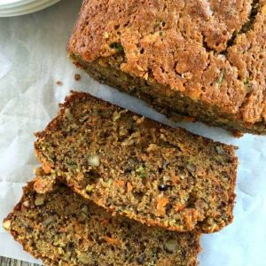 A loaf of carrot zucchini bread cut into slices