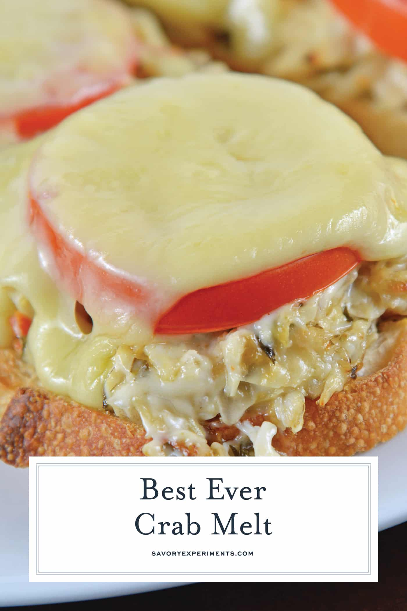 This Crab Melt will become your favorite open faced sandwich recipe! Deliciously cheesy and easy to make! #crabmelt #crabrecipes #openfacedsandwich www.savoryexperiments.com