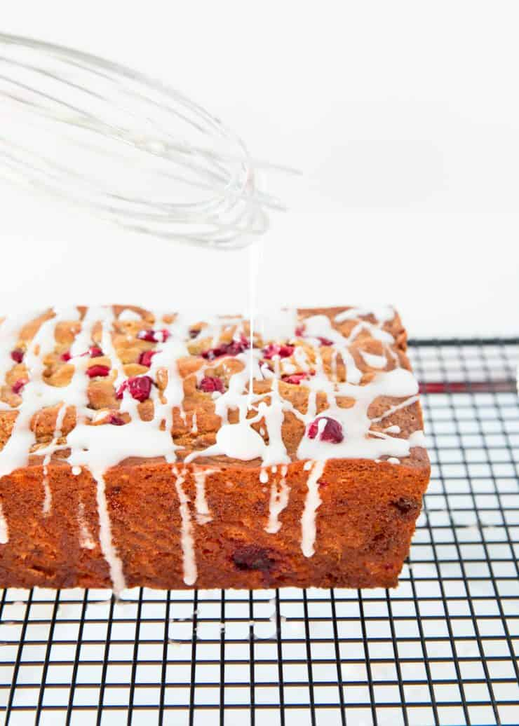 White chocolate cranberry banana bread with an icing drizzle