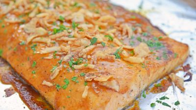 This BBQ Baked Salmon requires just 20 minutes and a handful of ingredients. Flavorful, quick and easy! Sure to become your favorite salmon recipe. #bakedsalmon #salmonrecipes www.savoryexperiments.com