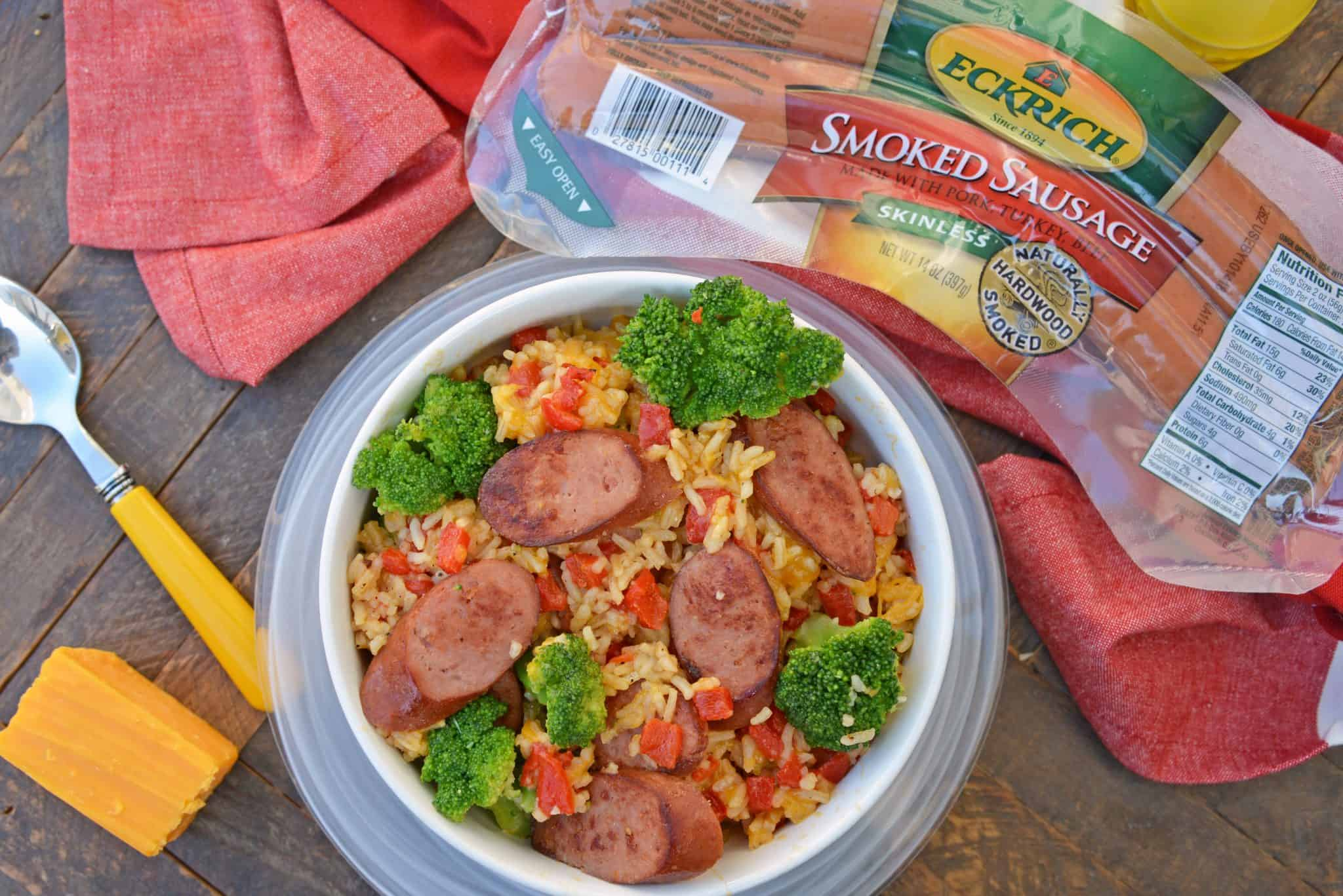 Sharp cheddar cheese tossed with rice, broccoli florets, roasted red pepper and tender Eckrich Smoked Sausage. Dinner is ready in just 15 minutes! #easydinnerideas #skilletmeals #onepandinner www.savoryexperiments.com