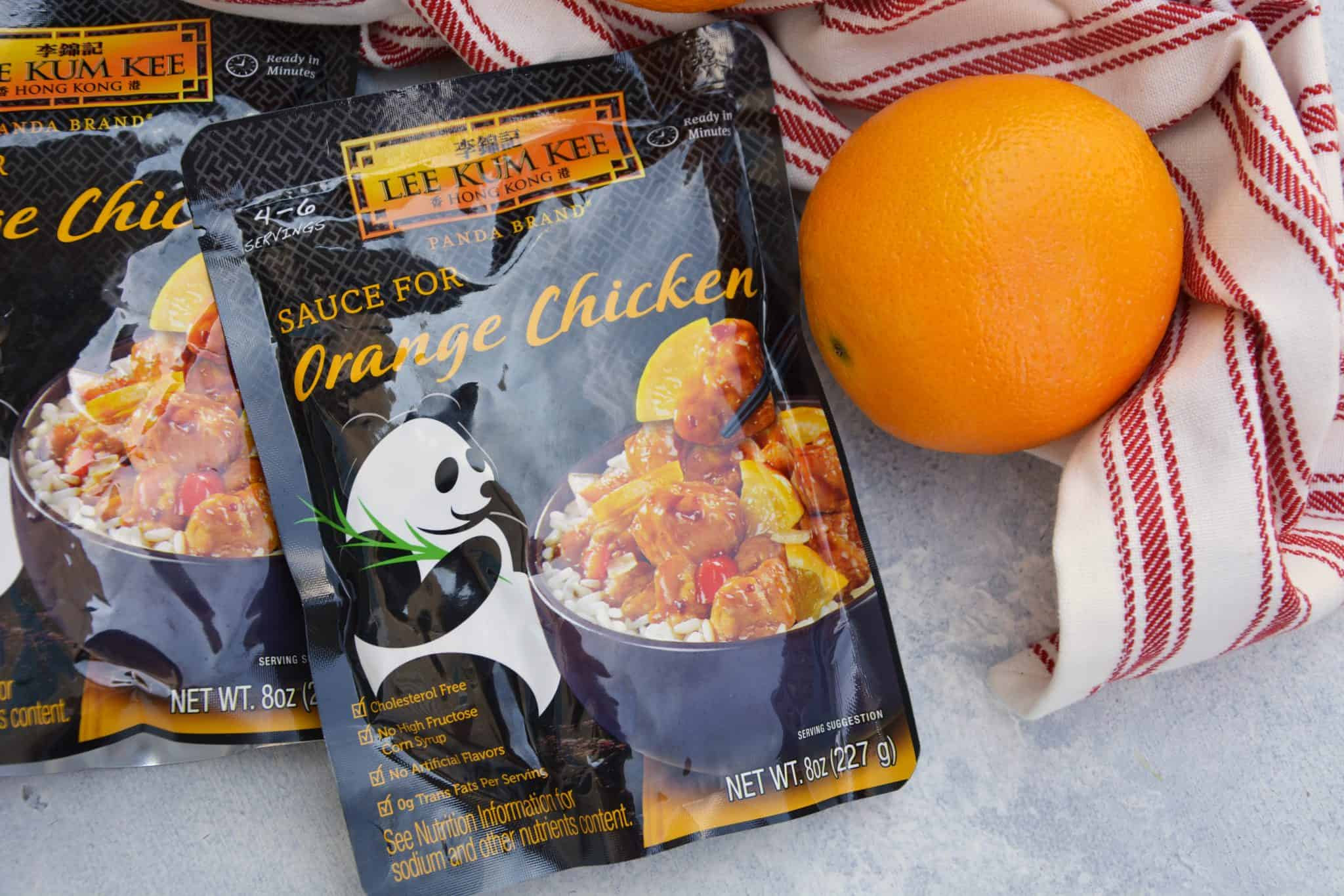 This post is sponsored by Lee Kum Kee, however 100% of thoughts and opinions are my own. This Chinese Orange Chicken recipe will fulfill all of your Chinese food cravings. Super easy in only 20 minutes and less than 10 ingredients and you will be digging into your better-than-takeout orange chicken! The ideal dinner solution for busy school nights. This Orange Chicken Recipe is amped up with bell pepper, baby corn and carrots in a delicious savory orange sauce over rice. Garnish with scallions, sesame seeds and orange zest for the best homemade Chinese food. When I think of delicious Chinese food, my mind goes straight to a hot plate of orange chicken. There is nothing like it. And I've never been able to create the sauce well at home, so I buy it. And my sauce of choice is Lee Kum Kee Panda Brand™ Ready Sauce for Orange Chicken! You can prepare a delicious Orange Chicken dish in minutes just by mixing your own fresh ingredients with this pre-made sauce. Lee Kum Kee Panda Brand™ Ready Sauce for Orange Chicken is stocked in my pantry for easy weeknight meals and dinner on the run. Whether it is a busy school night or I just want to spend less time in the kitchen and more time with my family, this sauce makes it easy to whip up a tasty meal in minutes. For my Orange Chicken recipe, I like to use chicken thigh fillets, although breasts are perfectly acceptable. The dark meat on thighs stay tender and juicy when cut smaller and fried whereas other cuts might dry out fast. As I was making this Easy Orange Chicken (and stealing bites from the serving dish) my mind started to dream about the other awesome recipes I could make with it other than traditional Orange Chicken. What about Orange Chicken Egg Rolls? An Orange Chicken Pizza? With onions and broccoli florets? Why not grill drumsticks and baste them with this delicious Orange Sauce? And the list doesn't even stop at chicken! Shrimp, scallops and even beef all come to mind. The possibilities are endless and now I'm thinking up even more creative ways to use my favorite Chinese sauce. For today, I'll be serving it up traditionally. I guess my other daydream creations will have to wait for another weeknight in need of a quick dinner. Why choose Lee Kum Kee? They are a great-tasting brand and leading maker of 200+ authentic Asian sauces and condiments for over 100 years. Why recreate the wheel? Lee Kum Kee makes it easy to enjoy authentic, restaurant-quality Asian flavors in the comfort of your own home. You probably already have some of their sauces in your pantry and they can easily take your ho-hum recipes to a new level regardless of whether they are Asian inspired or not. You can feel good serving Panda Brand™ Sauce to your family because it is free of high fructose corn syrup, MSG and preservatives. They only use premium, non-GMO ingredients and also have several gluten-free options. In celebration of Lee Kum Kee's 130th anniversary, the brand is hosting a recipe contest for a chance to win a cash prize. Click HERE for more details and to learn more about the contest. Watch our Easy Orange Chicken Video!