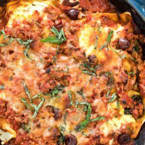 Greek lasagna in a cast iron skillet
