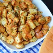 Hot Dog Bun Homemade Croutons with garlic, salt and parsley are the best for salads, soup and more! Learn how to make croutons easily with this crouton recipe. #homemadecroutons #croutonrecipe #howtomakecroutons www.savoryexperiments.com