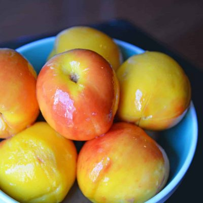 Learn how to peel a peach in just a minute! Super easy without cooking the peach. Perfect for sauces, salads, pies, cobblers and salsas! #howtopeelapeach #peelingpeaches www.savoryexperiments.com