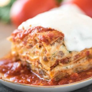 One slice of million dollar lasagna on a white plate