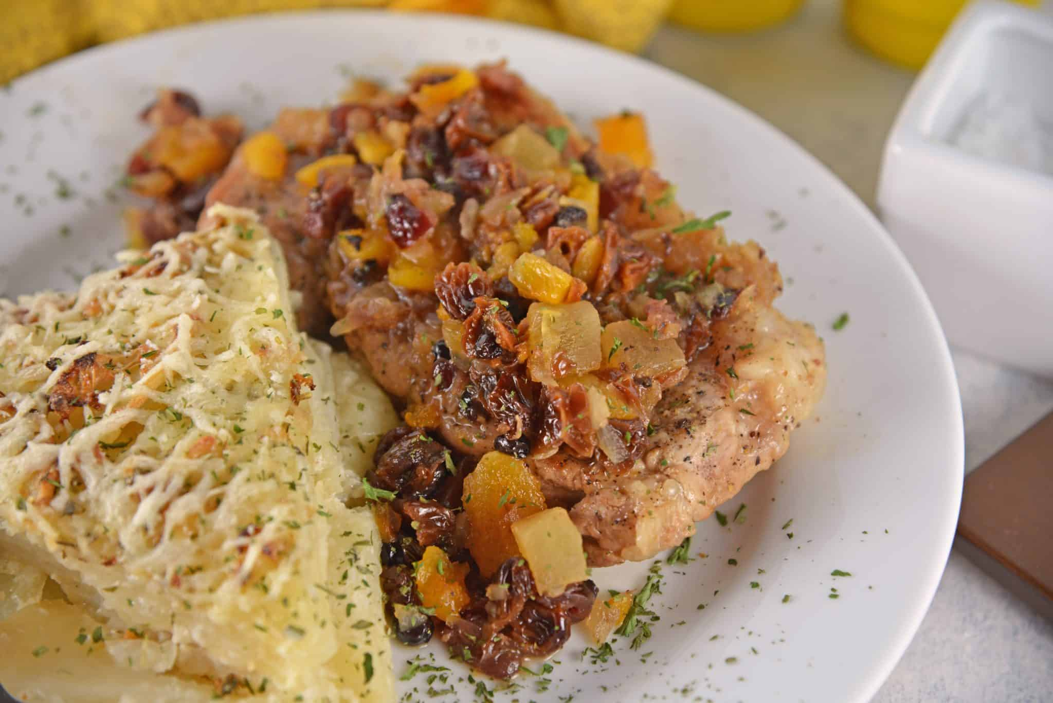 Mixed fruit pork chop on a white plate