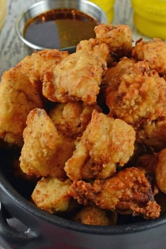 This Popcorn Chicken Recipe is a simple and easy to make deliciously crispy popcorn chicken bites at home. Great for game days, parties or even lunch! #popcornchicken #howtomakepopcornchicken www.savoryexperiments.com