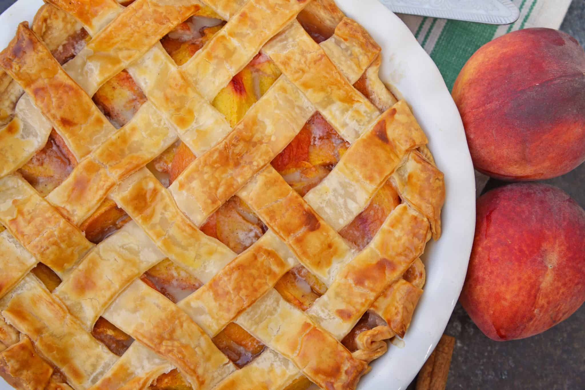 Southern Peach Pie a traditional peach pie using fresh peaches baked in a flaky, buttery lattice crust.#southernpeachpie #peachpie www.savoryexerperiments.com