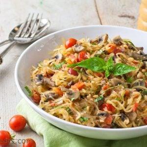 Tomato basil spaghetti squash pasta in a white bowl