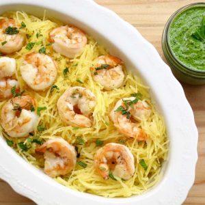 Shrimp pesto spaghetti squash in a white dish