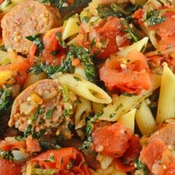 Spinach Sausage Pasta is an easy pasta recipe packed with flavor! Only a handful of ingredients and it's a one pot meal! Perfect for busy weeknights! #sausagepastarecipe #easypastarecipes #onepotmeal www.savoryexperiments.com