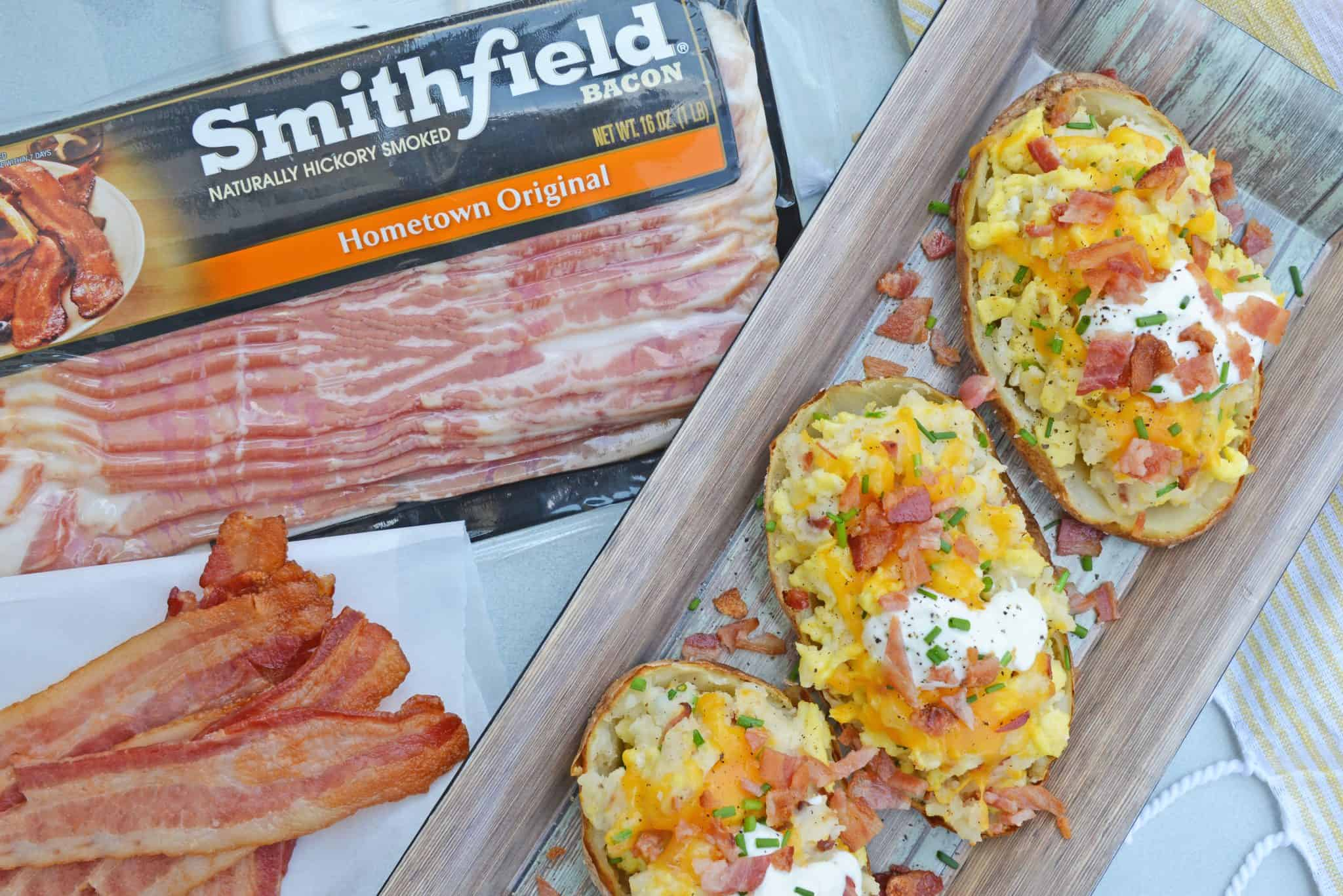 This post is sponsored by Smithfield, however all thoughts and opinions are 100% my own. Seriously? How is it already that time of the year again? It seems like we were just buying pool noodles and now we are looking for backpacks. Twice Baked Breakfast Potatoes use leftover potatoes with scrambled eggs, cheddar cheese, chives, sour cream and BACON for the perfect easy breakfast recipe. And with back to school comes the rigmarole of meal planning. Every meal of the day has its own challenges for different reasons, but one thing stands true, breakfast is the most important meal of the day! Smithfield is so passionate about the importance of breakfast, they have teamed up with No Kid Hungry for the second year in a row, doubling its donation to two million meals to support the organization's in-school breakfast programs to ensure the 1 in 6 American children struggling with hunger can have a satisfying and quality breakfast too. How can you get involved? Make a Smithfield breakfast and share a photo of it on Facebook, Instagram and Twitter using #BreakfastPower and for every post shared, Smithfield will donate enough for 10 meals to No Kid Hungry. Learn more HERE! Studies show that when students have a hearty and wholesome breakfast in the morning, they are more likely to attend school and perform better on standardized tests making breakfast a powerful learning tool. In fact, when students don't get the food they need, 76% of teachers see poor academic performance and 80% see the students lose the ability to concentrate (source: No Kid Hungry). Quality of breakfast is just as important as having breakfast, but with a little bit of planning, you can be serving your little ones (or big ones!) a protein-packed breakfast that will fuel them through the morning. My favorite: Twice Baked Breakfast Potatoes! This is my favorite for several reasons. First, I can use leftover baked potatoes to make breakfast. I hate wasting food and also hate eating the same thing, so I can make two meals with the same set of baked potatoes. The second is how easy they are to make and how they can be prepared ahead of time. I go ahead and assemble the whole stuffed potato and then just pop it in the oven for a few minutes to warm them up! Smithfield Hometown Original Bacon provides the protein boost you need as well as scrambled eggs and cheddar cheese, while potatoes give complex carbohydrates and dietary fiber. Smithfield Hometown Original Bacon is smoked and cured and comes in different flavors and cuts like Cherrywood and Thick Cut so you can customize your Twice Baked Breakfast Potatoes. And since bacon makes everything better, I usually make a few extra crispy strips to serve on the side of my potato. If you liked our Twice Baked Breakfast Potato, you'll love these other breakfast recipes that use bacon too! • Bacon, Egg and Cheese Breakfast Bread • Creamy Cheddar Grits • Stuffed Breakfast Potatoes So really the only question left is do you like your breakfast potatoes and eggs with ketchup, hot sauce or plain? Personally, I like mine plain so I can really taste ALL the flavors! {RECIPE CARD} Potatoes: 2 large russet potatoes, cooked* 2 tablespoons butter, divided 3 eggs, lightly beaten ½ cup Smithfield Hometown Original Bacon, cooked and crumbled 2 tablespoons sour cream ¼ cup cheddar cheese, shredded 1 tablespoon chives, minced ¼ teaspoon garlic powder ¼ teaspoon ground black pepper Toppings: Smithfield Bacon Hometown Original Chives Sour Cream Sea Salt Hot Sauce Ketchup Preheat oven to 350 degrees. In a small skillet, melt 1 tablespoon butter. Add lightly beaten eggs, stirring until scrambled and just cooked. Do not overcook. Set aside. Cut large, cooked potatoes in half lengthwise. Using a spoon, hallow out skins. Place potato pulp in a medium mixing bowl. Place potato skins on a baking sheet. Mash potato pulp with sour cream and 1 tablespoon butter. Stir in shredded cheddar cheese, chives, garlic powder and ground black pepper, mix well. Using two forks, toss scrambled eggs with potato mixture. Do not over mix, just lightly toss. Fill potato skins, mixture will be heaping. Place back into oven for 10 minutes, or until hot all the way through. Immediately top with additional cheddar cheese, crumbled bacon, chives and any additional condiments you desire. If you've given our Twice Baked Breakfast Potatoes a try, make sure to come back through and let us know how they were! *Use leftover baked potatoes or pierce your potato several times and microwave for 4-5 minutes. The size of potato and power of your microwave will make cooking time vary greatly, please keep an eye out while it cooks! *Hot potatoes tend to work better. If you are using leftovers, scoop out the potato and heat in the microwave before mashing. {END RECIPE CARD} You can find your own Smithfield Bacon at your local retailer or grocery store!