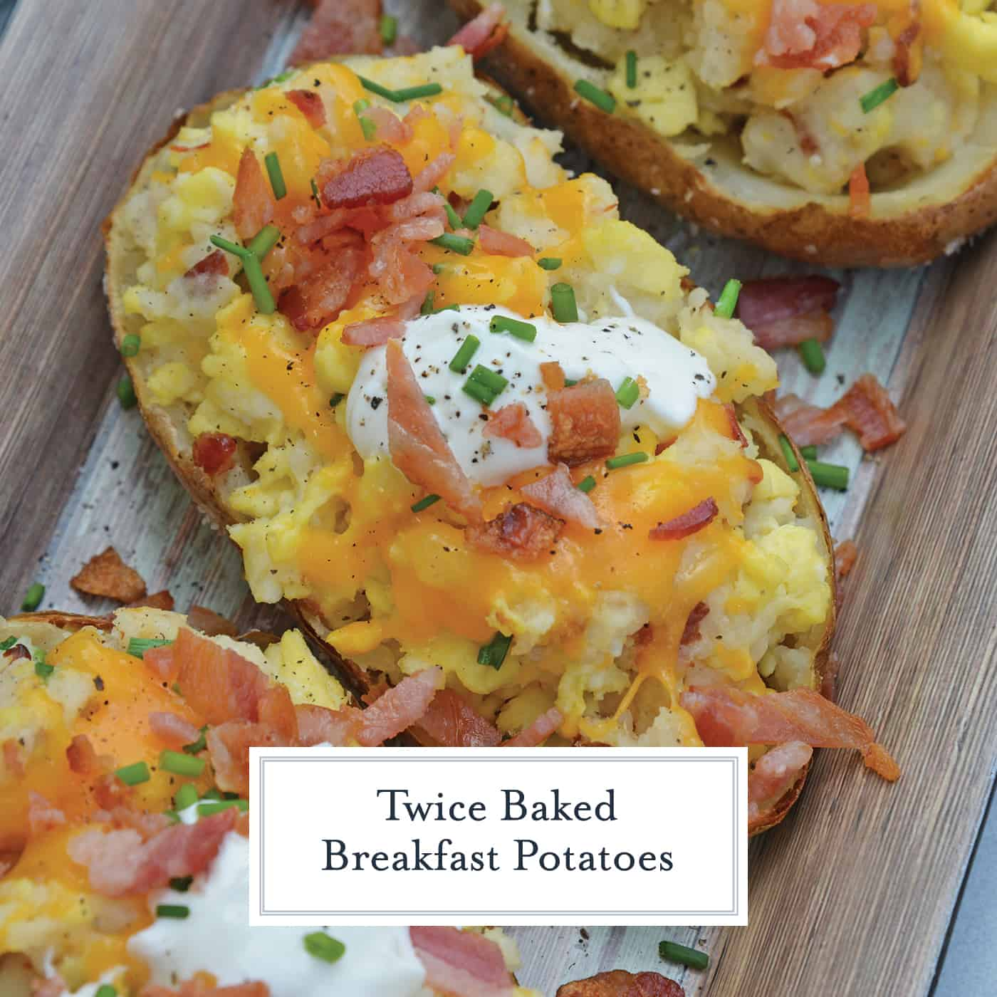 Twice Baked Breakfast Potatoes use leftover potatoes with scrambled eggs, cheddar cheese, chives, sour cream and BACON for the perfect easy breakfast recipe. #breakfastpotatoes www.savoryexperiments.com