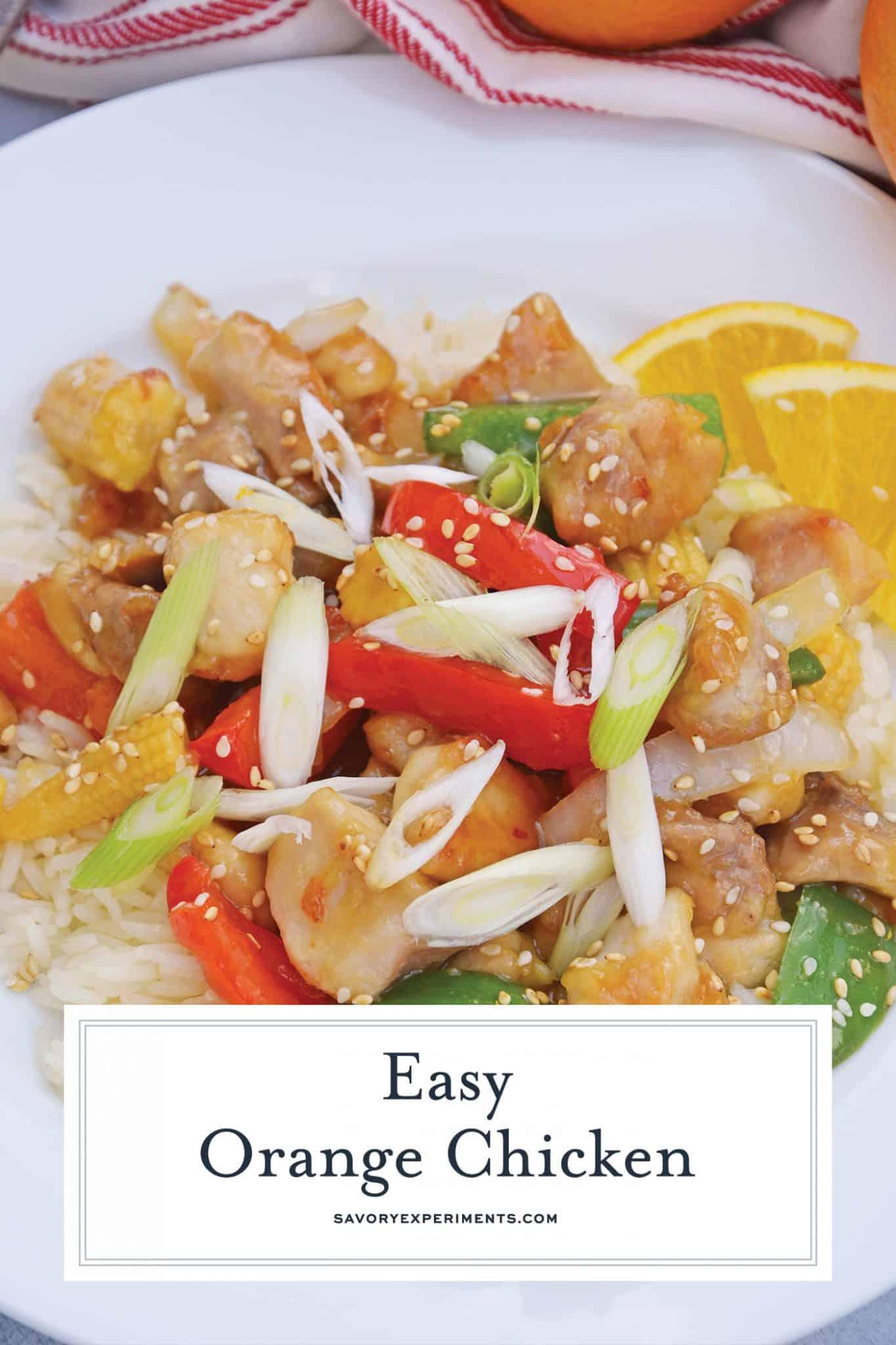 This Orange Chicken Recipe is amped up with bell pepper, baby corn and carrots in a delicious savory orange sauce over rice. Garnish with scallions sesame seeds and orange zest for the best homemade Chinese food.#homemadeorangechicken #orangechickenrecipe www.savoryexperiments.com