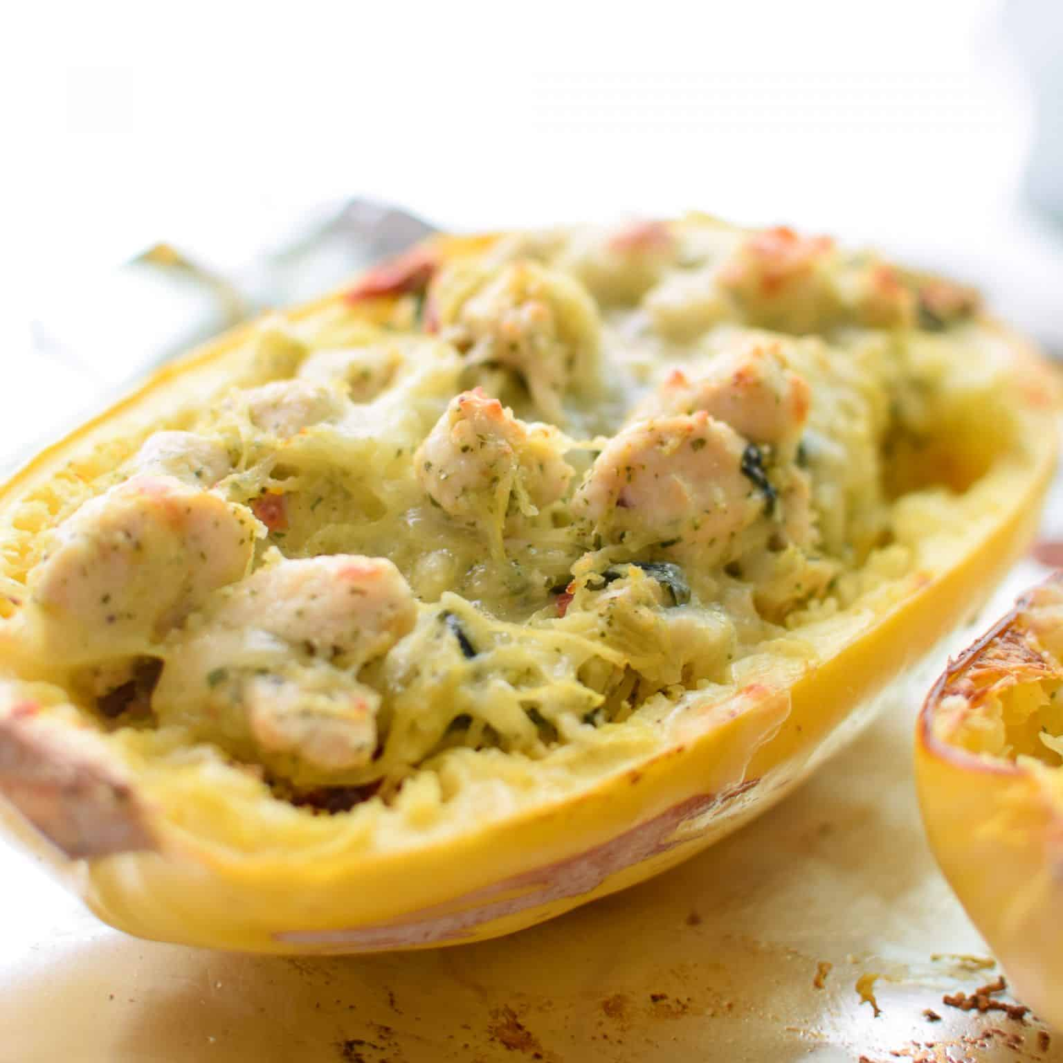 Pesto chicken spaghetti squash cut in half