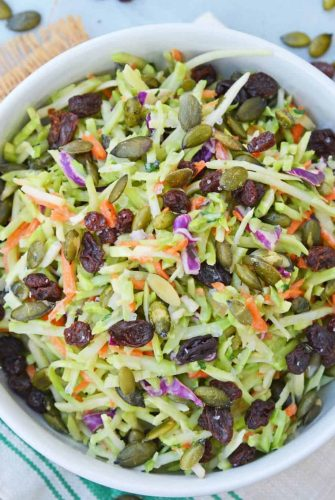 This Crunchy Broccoli Slaw Salad is made with a bagged broccoli slaw and a few extra ingredients for a quick, easy and tasty side salad! #broccolislaw #broccolisalad www.savoryexperiments.com