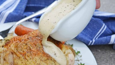 Easy Chicken Gravy made with chicken drippings is the best homemade chicken gravy recipe! It only takes 10 minutes and ingredients you already have in your pantry.#chickengravyrecipe #homemadechickengravy www.savoryexperiments.com