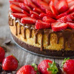 Chocolate covered strawberry cheesecake with strawberries