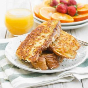 Coconut french toast on a white plate