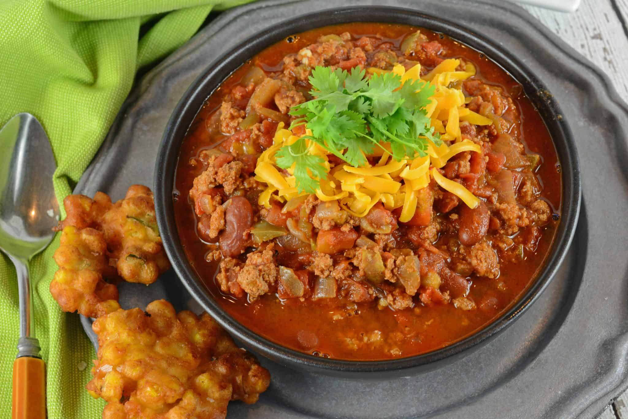 Easy Chili in a gray bowl topped with cheese