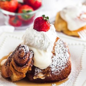 Cinnamon roll french toast with whipped cream and berries