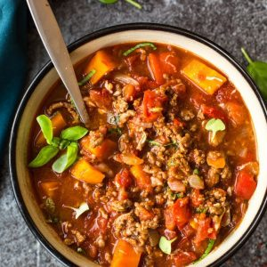 Italian Instant Pot chili in a pot with a ladle